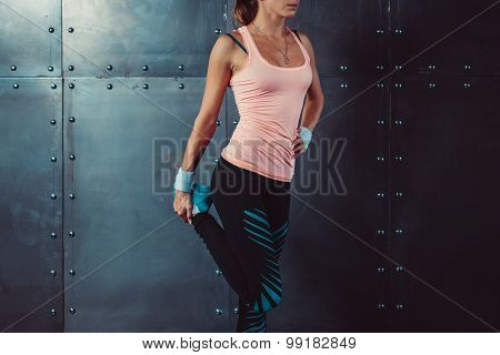 fitness woman stretching her legs Fit female runner doing stretches. Preparation for workout sport,