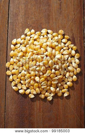 heap of the maize corn on the wooden table