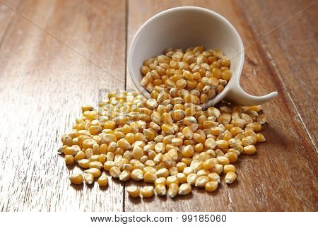 cup of the maize corn on the wooden table