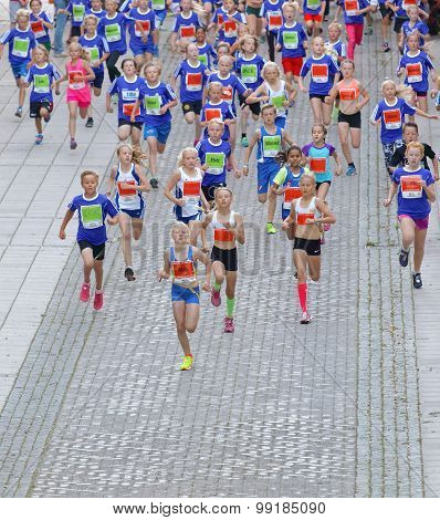Large Group Of Running Girls And Boys In Blue