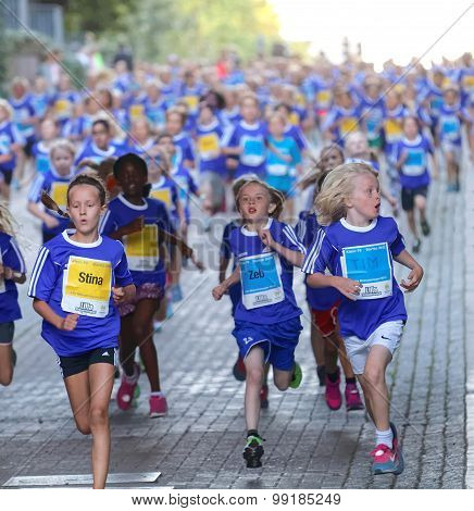 Large Group Of Running Girls And Boys