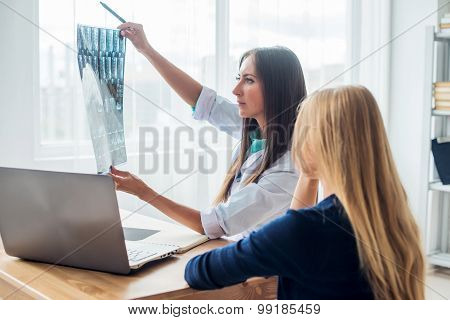 doctor and patient looking at x-ray or MRI concept healthcare, medical radiology concept.