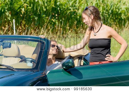 A Young Couple With Convertible Car