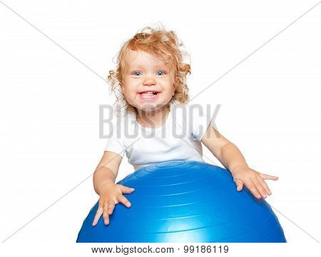 Smiling Blond Baby With Gymnastic Ball.