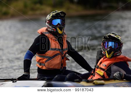 ST. PETERSBURG, RUSSIA - AUGUST 15, 2015: Irina Krylova (right) and Dmitry Krylov prepare to the start of second stage of the River marathon Oreshek Fortress race. This competitions is held since 2003