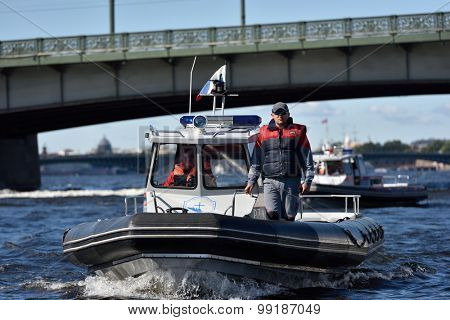 ST. PETERSBURG, RUSSIA - AUGUST 15, 2015: Search and Rescue Service boats during the River marathon Oreshek Fortress race. This international motorboat competitions is held since 2003
