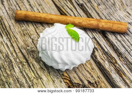 White marshmallow with peppermint on rustic wood