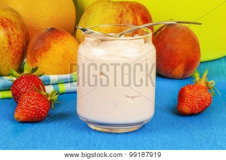 Fresh strawberry yogurt with fruit around
