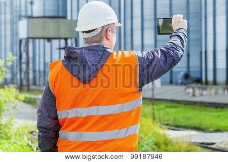Engineer filmed with cell tablet PC at the factory