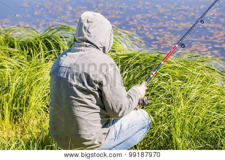 Man with fishing rod at the lake