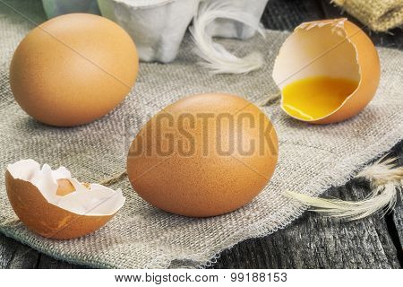 Fresh chicken eggs on wooden table