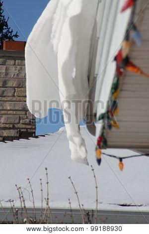 Snow Drift on House Eave