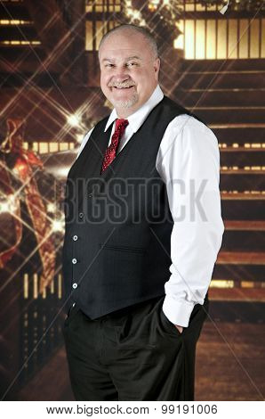 Portrait of a happy senior man standing near a staircase decorated with Christmas lights.