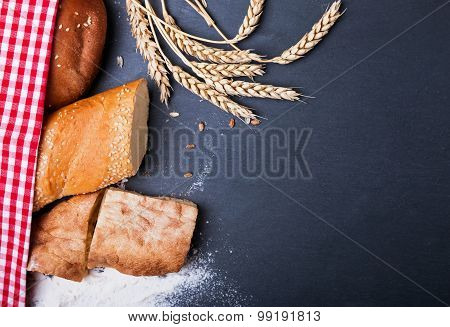 Different Kinds Of Bread, Wheat And Flour On The Black Background