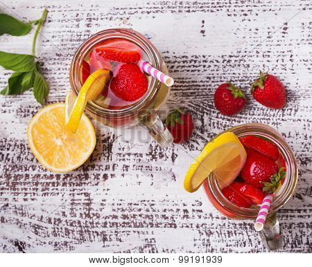 Strawberry And Lemon Detox Water In Glass Jars