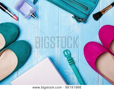 Bright Woman Accessories On Blue Wooden Background
