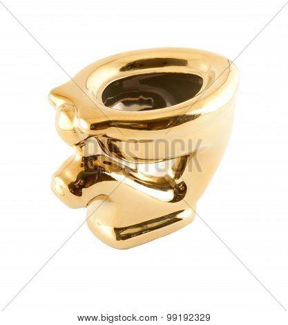 Golden Toilet Bowl On A White Background.