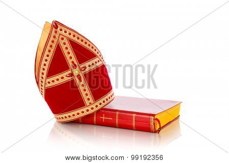 Mitre or mijter and book of Sinterklaas. Isolated on white backgroud. Part of a dutch santa tradition