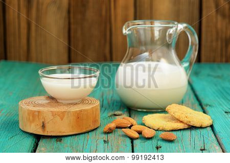Homemade Fresh Almond Milk In Glass Jar And Glass Bowl, With Homemade Almond Cookies And Whole Almon