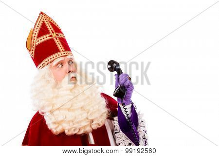 Sinterklaas with old vintage telephone. isolated on white background. Dutch character of Santa Claus