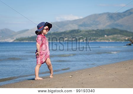 Happy Girl In Hat And Sunglasses, Walking Near Sea