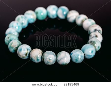 Genuine Larimar Round Beads Bracelet isolated on black