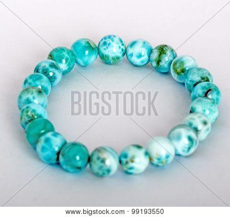 Genuine Larimar Round Beads Bracelet isolated on white