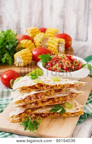 Mexican Quesadilla wrap with chicken, corn and sweet pepper and salsa.