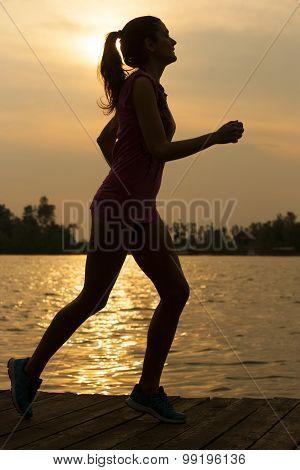 Young Girl Running Jogging Near Water