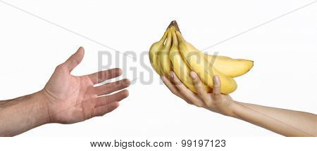 Giving food to a poor man.feeding people.Giving bunch of banana.