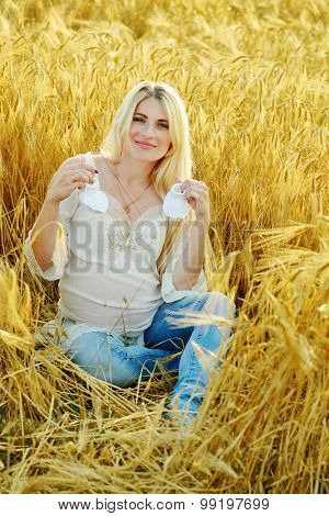 Pregnant Woman  In Wheat Field