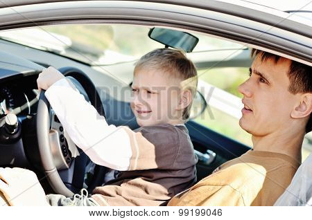 Father And Son  In A Car