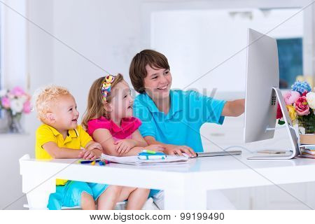 Kids Doing Homework With Modern Computer