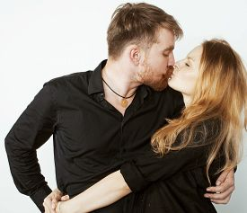 stock photo of fool  - young hipster couple fooling around on white background close up - JPG