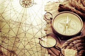 picture of wind-rose  - Compass and glasses on antique map - JPG