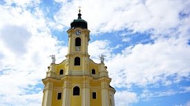 stock photo of hughes  - historical church tower close up Austria with blue sky clouds background - JPG