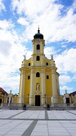 picture of hughes  - historical church tower Austria with blue sky clouds background - JPG