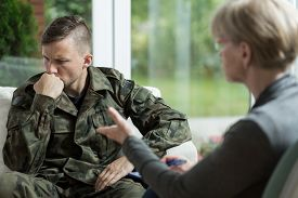 picture of veterans  - War veteran talking about problems during therapy - JPG