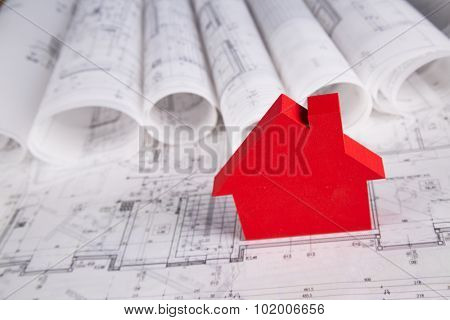 Architectural project and Yellow helmet and house model