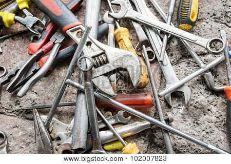scattered spanners and screwdrivers on the ground