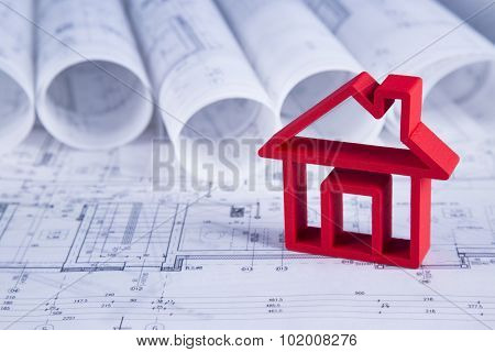 House model with blueprint drawing