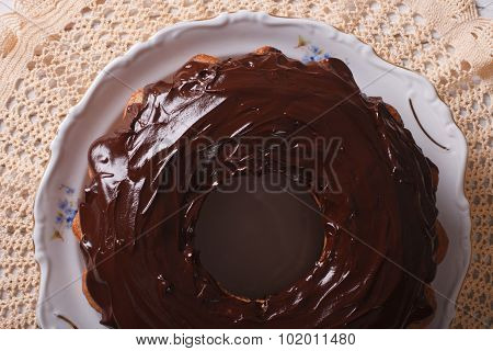 Fancy Bread Cake With Chocolate Icing Close-up. Horizontal Top View