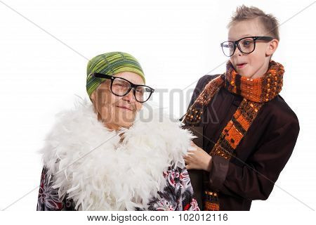 Cheerful And Joyful Grandmother And The Grandson Communicate Playing, In The Hipster Glasses
