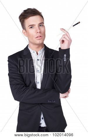 portret of stylish young men with make up brush in the studio isolated on white background
