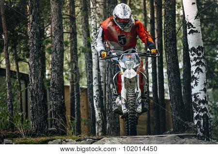 Racer motorcycle across bridge
