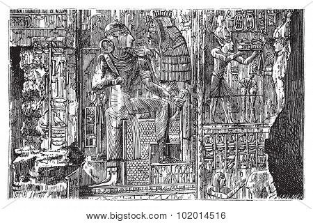 Abydos, Egypt. Bas-relief illustration of hieroglyph carvings on the wall. Complex scene carving of egyptian god and Pharaoh. Live trace vector.