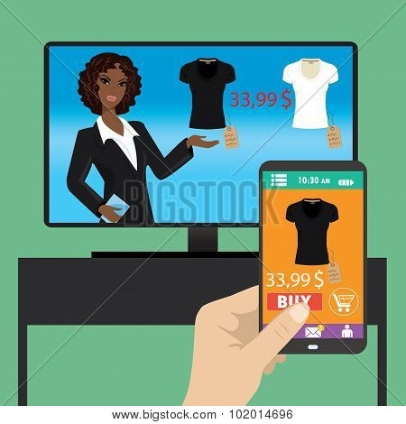 Woman is purchasing black t-shirt online in TV shop using smart