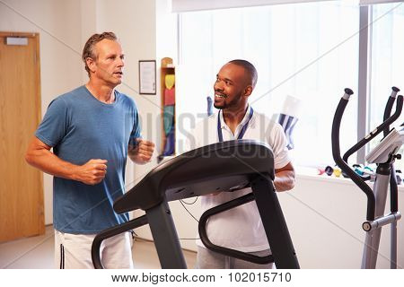 Patient Using Treadmill In Hospital Physiotherapy Department