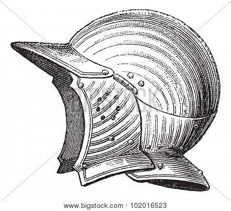 Pot head medieval armor helmet vintage engraving. Old engraved illustration of ancient helmet. Trousset encyclopedia