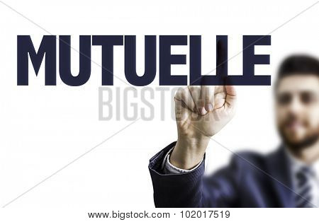 Business man pointing the text: Mutual (in French)